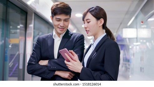 Asian business people use smart phone on the mrt platform