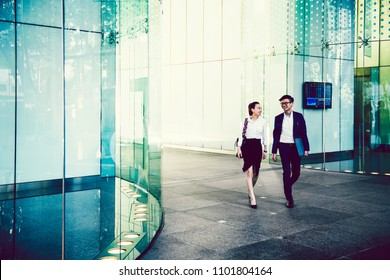 Asian business people walking in Singapore