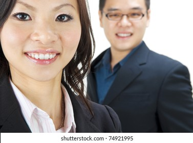 Asian business team, focus is on the woman.