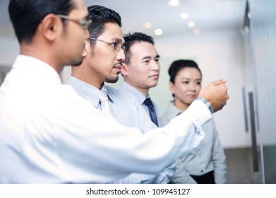 Asian business Team In Meeting