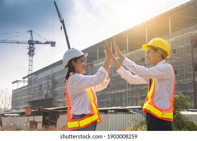 Asian business team worker engineer success on site construction