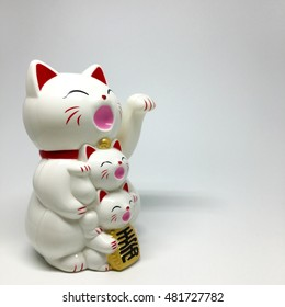 """Asian business welcome sign : """"maneki neko """" japan popular cat with smiley face for welcome all customer at front shop on white space"""