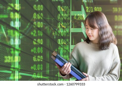 Asian business woman analyzing about business investment in financial with datasheet and document in her hand. Concept of business, economy, market, and investment.