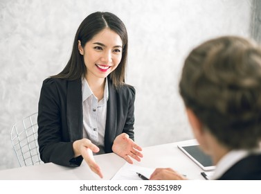 Asian business woman discussing/job interview with colleauge/boss for business meeting