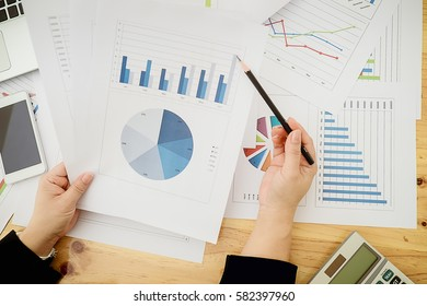 Asian Business woman discussion and analysis data the charts and graphs showing the results at meeting. Business finances and accounting concept