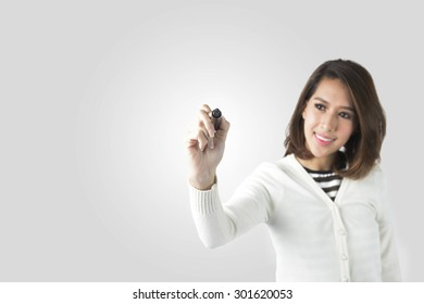 Asian Business Woman Drawing On The Transparency Board