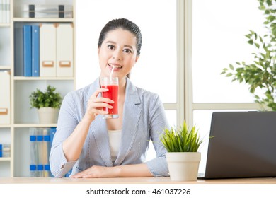 asian business woman enjoy to drinking fresh watermelon juice in office