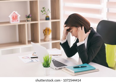 Asian business woman feel stress from work. Stress at work and the concept of emotional pressure.