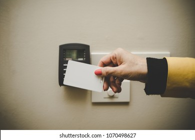 Asian business woman hand holding Access card / Key Card eletronic door accessing control scanning to lock and unlock door. Security scan door open / close Automatic Technology system concept