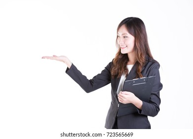 Asian business woman hand posting copy space ,25-35 Year old,formal business wear suit,white collar worker