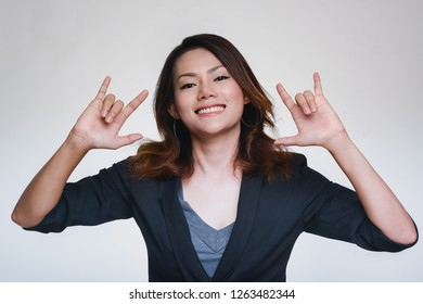 Asian business woman hand raised hands showing happy feelings.focus on face