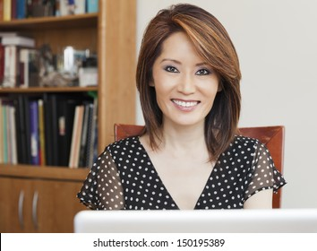 Asian business woman in her office