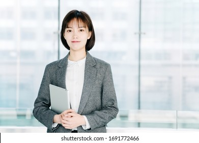 asian business woman holding a tablet computer