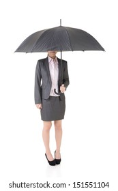 Asian business woman is holding umbrella with half hidden face under it. Isolated on the white background.