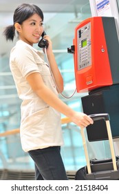 asian business woman making a call at airport