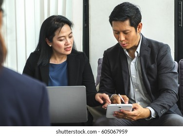asian Business woman and man using tablet,notebook to planing work at corporate meeting in office,Business conference concept