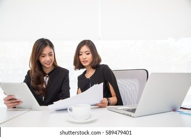 Asian business woman meeting and talking with their task in the office room.