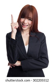 Asian Business woman pointing up to copy space on white background