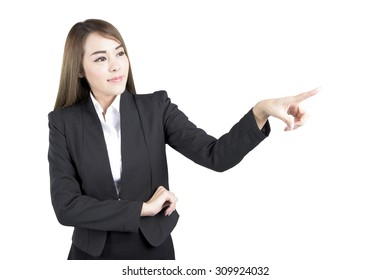 Asian Business Woman Pointing at Empty Space. Concept for Business Presentation
