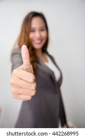 asian business woman pointing with her hand at you