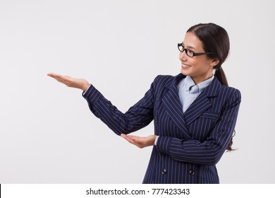 asian business woman pointing sideway
