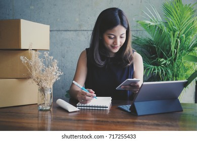 Asian business woman selling business online marketing in coffee shop cafe