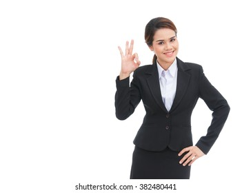 Asian business woman showing ok sign isolated on white background