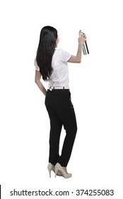Asian business woman spraying something isolated over white background