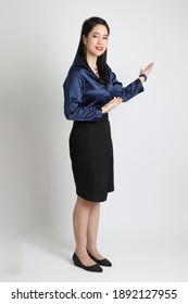 The Asian business woman standing on the white background.