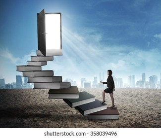 Asian business woman stepping up stair made from book. Business knowledge concept