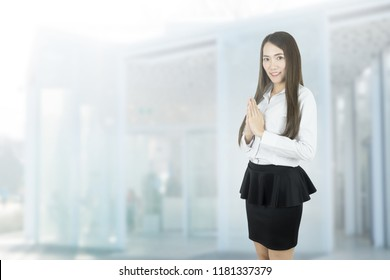 Asian business woman with Thai culture Sawasdee, Welcome expression Sawasdee with blank copyspace.