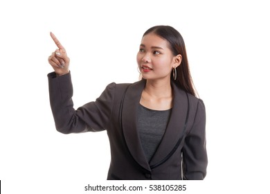 Asian business woman touching the screen with her finger isolated on white background.