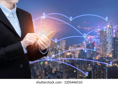 Asian business woman use smartphone technology in Smart city with communication network and big data system.