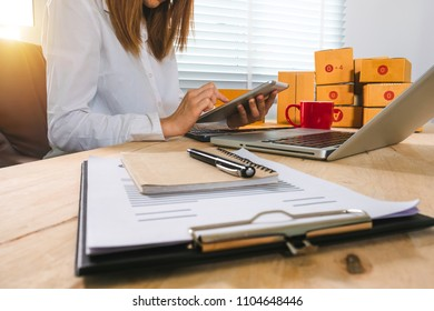Asian business woman using laptop at office of her business online shopping.in home office