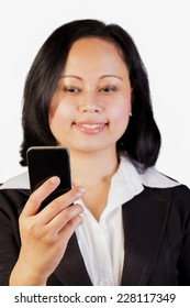 Asian Business Woman using mobile phone in office