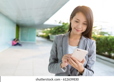 Asian business woman using mobile phone in Bangkok city