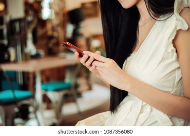 Asian business woman working in in coffee shop cafe with  paper work  (Business woman and order online concept.)