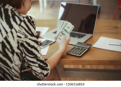 Asian business woman working in in coffee shop cafe with laptop paper work happy money online shopping  (Business woman concept.)