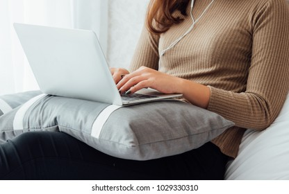 Asian business woman working with laptop computer and drink coffee in living room