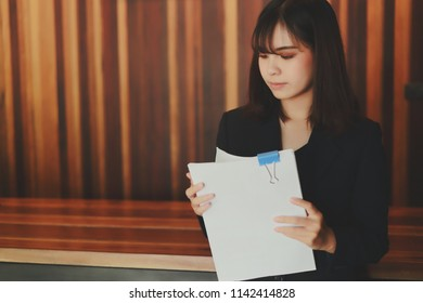 Asian business woman working in in offeice with  paper work document report to manager  (Business woman concept.)