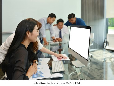 Asian Business women using laptop with blank screen in meeting room