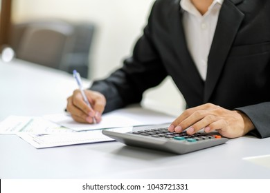 Asian Businessman accounting money salary at office, Man Accountant calculate document data with calculator. Finance, Investment, Marketing and management concepts