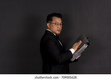 Asian businessman in action with briefcase.