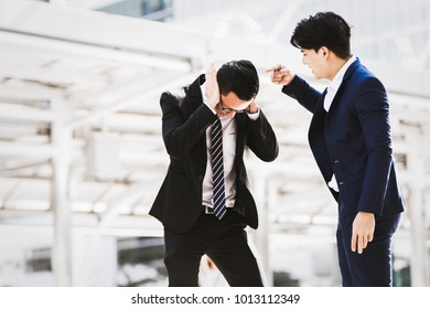 Asian businessman angry worker background city. Business concept