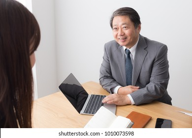 asian businessman and businesswoman