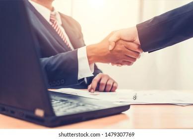 Asian businessman and businesswomen Handshaking.Successful businessmen handshaking after good deal.Handshake Gesturing People Connection Deal Concept.vintage color tone.