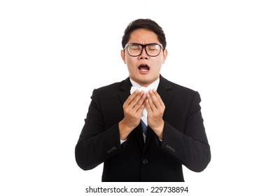 Asian businessman caught cold. Sneezing into tissue.  isolated on white background