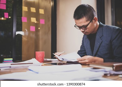 asian businessman checking data and working at night