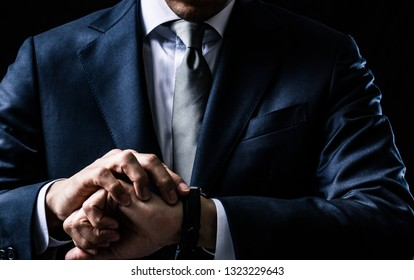 Asian businessman checking the watch