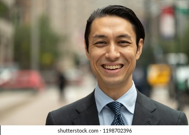 Asian businessman in city smile happy face portrait